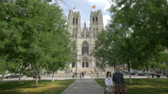 King Baudouin bust statue and St Michael and St Gudula Cathedral, Brussels Stock Footage