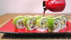 Green Sushi Rolls and Pour the Sauce into a Defocus Dolly Shot 4K Stock Footage