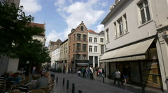 People gatehred near Chocolaterie Manneken Pis in Brussels Stock Footage