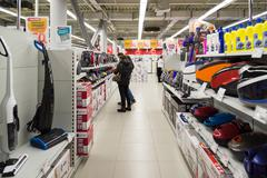 Moscow, Russia - February 02. 2016. Customers choose a vacuum cleaner in Stock Photos