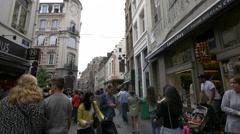 Many people walking on Rue de l'Etuve in Brussels Stock Footage