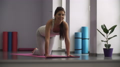 Woman doing exercises for legs on exercise mats Stock Footage