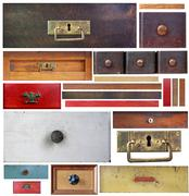 Old drawers, wooden strips and escutcheons on white background - stock photo