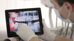 Dentist Shows A Patient X-Ray On The Tablet Stock Footage