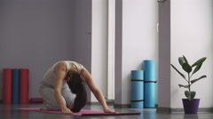 Woman doing yoga exercises and relax Stock Footage