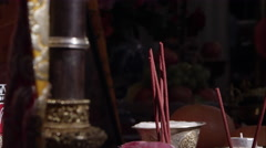 Stock Video Footage of Tilting down shot of ornate bowls, cups, and insence.