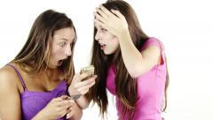 Girls discovering bad news reading text message on cell phone Stock Footage
