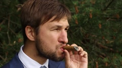 Man smoking cigar Stock Footage