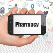 Medicine concept: Hand Holding Smartphone with Pharmacy on display - stock illustration
