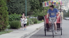 Stock Video Footage of Young girl and boy chasing a rickshaw. Then geting in.