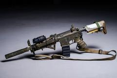 Assult automatic rifle with silencer Stock Photos