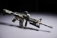 Automatic rifle M16 with LED flashlight - stock photo