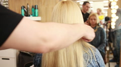 Barber makes the cut for adult woman Stock Footage