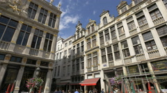 Tourists walking in Grand Place and on Rue au Beurre in Brussels Stock Footage