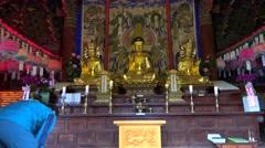 Praying man in the Sinheungsa Buddhist temple. Seoraksan NP, South Korea. Stock Footage