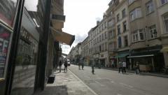 Little boy riding a bike on Rue du Midi in Brussels Stock Footage