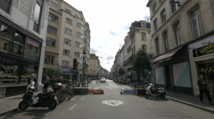Midi street with bikes and motorcycles in Brussels Stock Footage