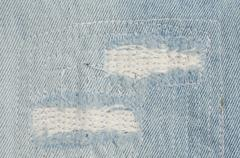blue faded ripped jeans, close up - stock photo