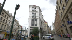White building between two streets in Brussels Stock Footage