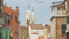 Two churches towers seen in the distance in Venice Stock Footage