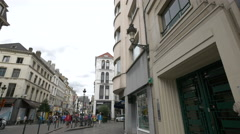 Adults and children walking on Rue du Midi in Brussels Stock Footage