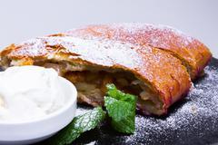 Apple pie (vienna strudel) with ice cream Stock Photos