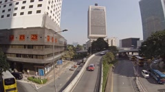 Typical traffic including buses and cars at a highway junction in Hong Kong Stock Footage