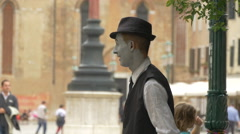 Man dressed like Charlie Chaplin performing on the street in Venice Stock Footage