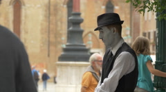 Man wearing a Charlie Chaplin costume performing on the street in Venice Stock Footage
