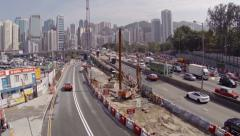 Highway construction with Hong Kong's skyline in the background. FullHD video Stock Footage