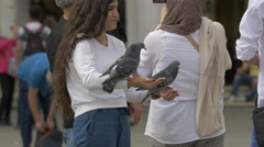 Girl holding pigeons in Venice Stock Footage