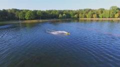 Man makes jump stunt during ride by Putyaevskii pond Stock Footage