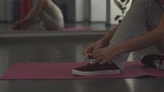 Girl tying shoelaces on sneakers Stock Footage
