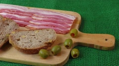 Cutting board with bacon and bread Stock Footage