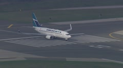 Early Morning WestJet 737 Takeoff Track Stock Footage