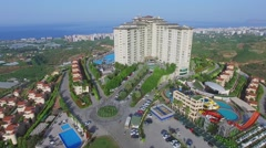 Gold City tourism complex with pool and city on sea shore Stock Footage