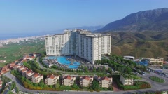 Gold City tourism complex on mountain and cityscape Stock Footage