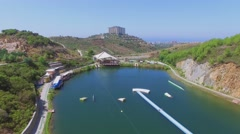 Wake Park and Gold City tourism complex against coastal town Stock Footage