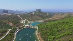 Cityscape and Golden Cable Park at summer sunny day. Stock Footage