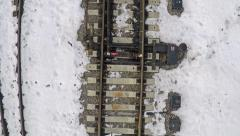 Rails and sleepers in snow. Aerial shot Stock Footage