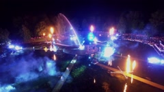 Many people watch performance with fireworks on Garden pond Stock Footage