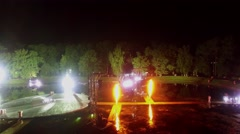 Fireworks on stage with light equipment on Garden pond Stock Footage
