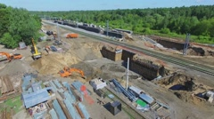Construction site of MKZD railway near station and cityscape Stock Footage
