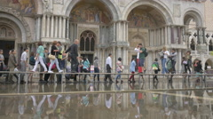 Tourists walking on temporary walkways in Piazza San Marco, Venice Stock Footage