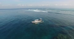 AERIAL static shot of boat near coral reef in Bali Indonesia Stock Footage