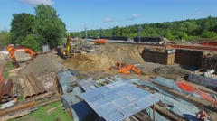 Excavator works on building site of MKZD railroad Stock Footage