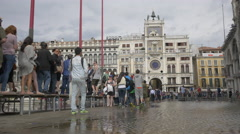 Tourists walking on passarelle in Piazza San Marco, Venice Stock Footage