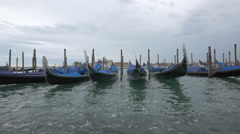 Black and blue gondolas in Venice Stock Footage