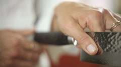 Chef holding a kitchen knife Stock Footage