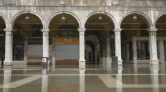 Procuratie Nuove's arcades seen during floods in St Mark's Square, Venice Stock Footage